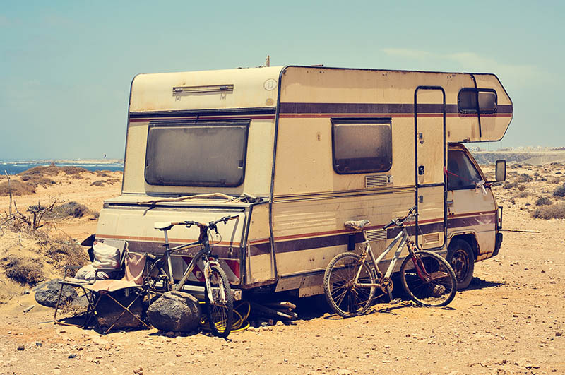 aged motorhome close to the sea, with a filter effect